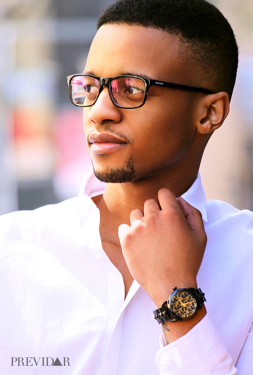 Mongezi fixes a white crisp shirt collar by Topman Sandton. Styled by Rea Kalape. Photographed by Lawrence Manyapelo.