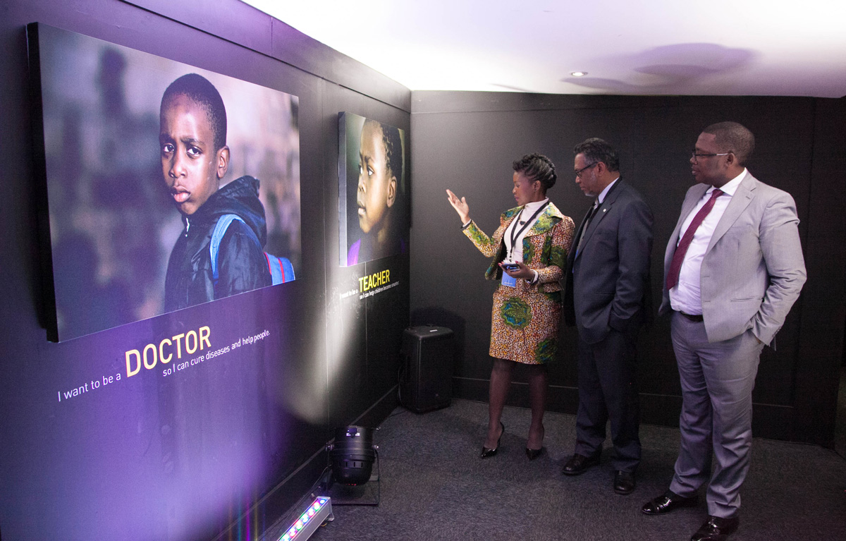 Unilever Corporate Affairs Director South & Central Africa, Sibonile Dube guides UNICEF South Africa Country Director, Herve Ludovic de Lys and Gauteng MEC for Education, Panyaza Lesufi through the exhibition.