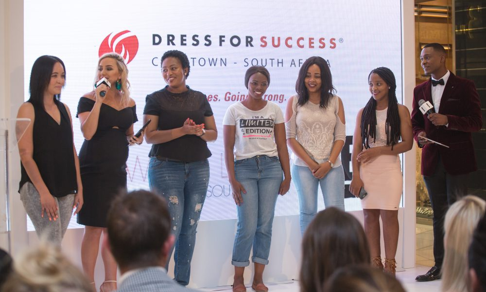 Dress For Success ladies after with Roxy Burger and Kat Sinivasan on stage at the reveal of HOW DO I LOOK SOUTH AFRICA pop-up shop (IMAGE CREDIT E! Entertainment Television)